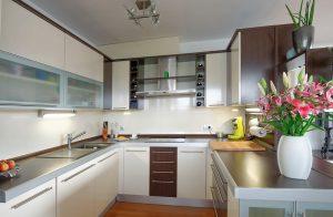 A small, cream kitchen installation